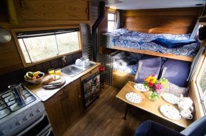 The inside of a handmade campervan available to rent from Quirky Campers