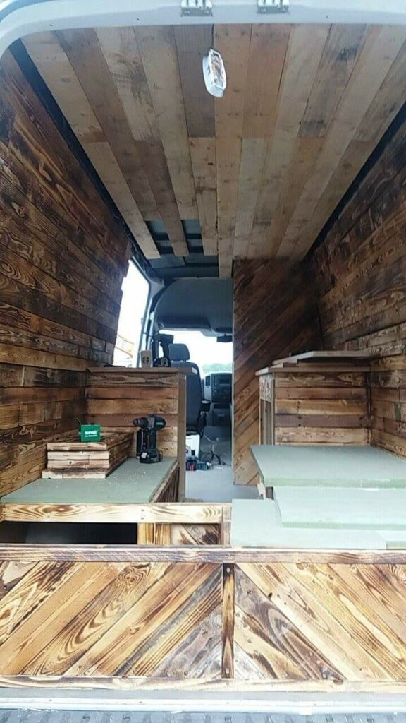 the inside of a campervan being converted
