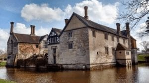 A National Trust house, Baddesley Clinton surrounded by a moat