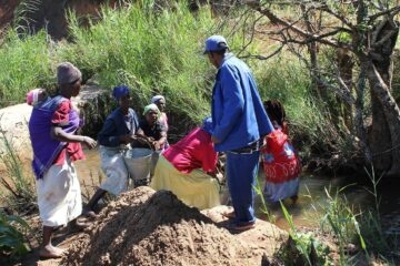 People in Zimbabwe constructing a micro hydro power plant and irrigation system