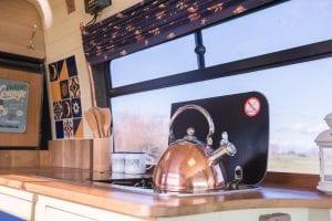 make a cup of tea in a campervan
