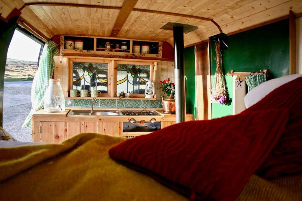 the inside of a selfbuilt campervan with stained glass