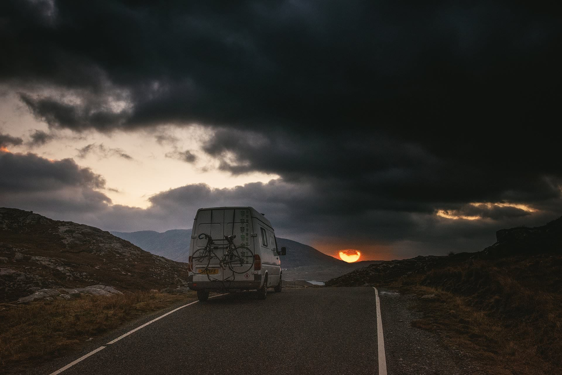 A Mercedes Sprinter on a sunset roadtrip in Ireland