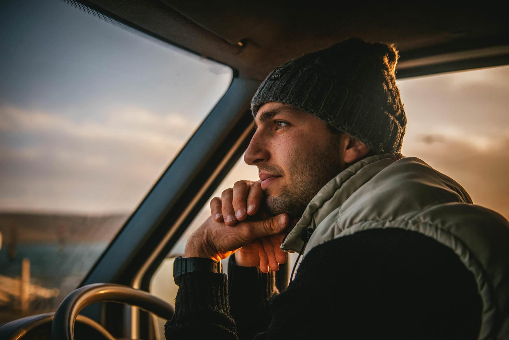 A man driving a campervan