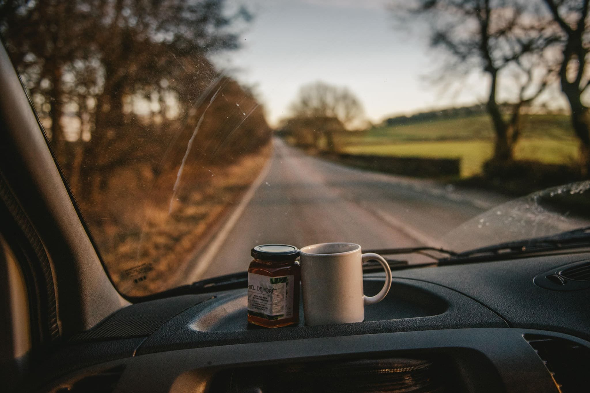 Tea and honey in a campervan on a roadtrip in Ireland