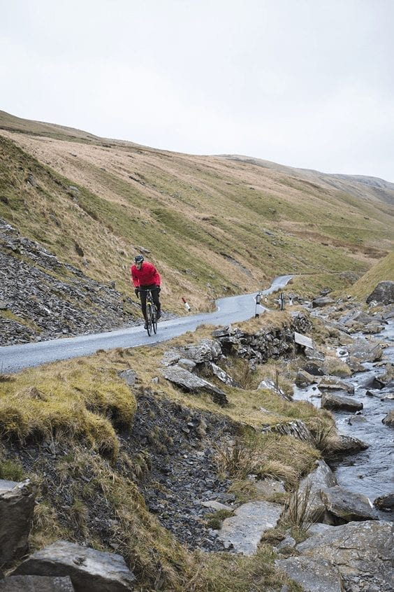 A man cycling in Wales