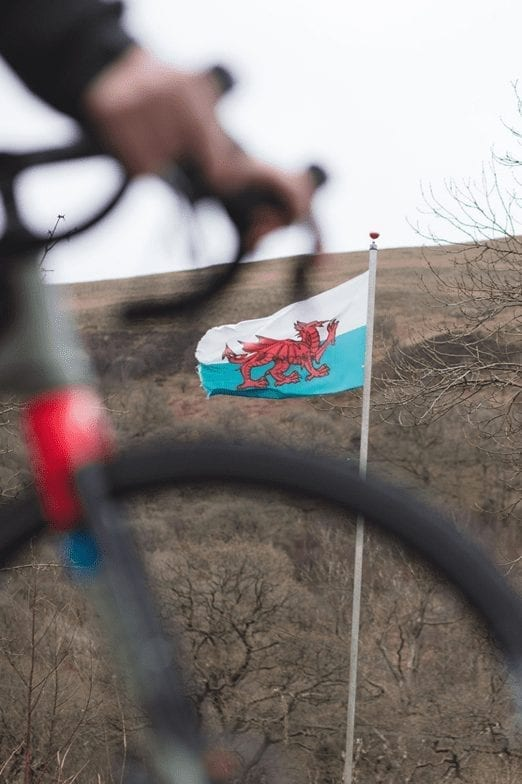 The Welsh flag in the background behind a bike