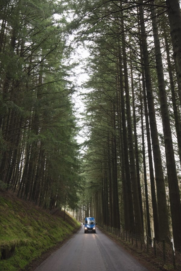 A campervan on a country road in Wales