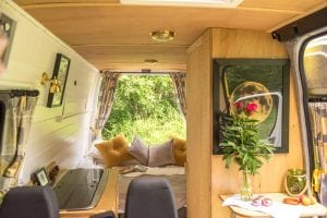 the final conversion of Mo. A light and airy van kitchen and bed area