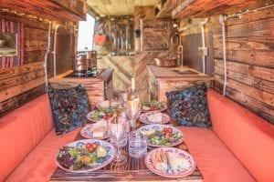 The dining area inside of a rustic handmade campervan