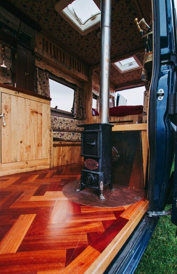 a wood burner inside a campervan conversion