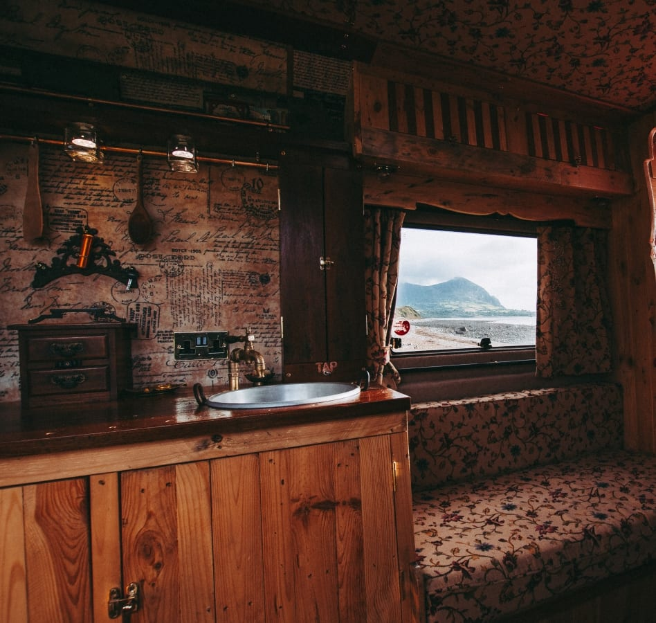 the kitchen area of a converted campervan