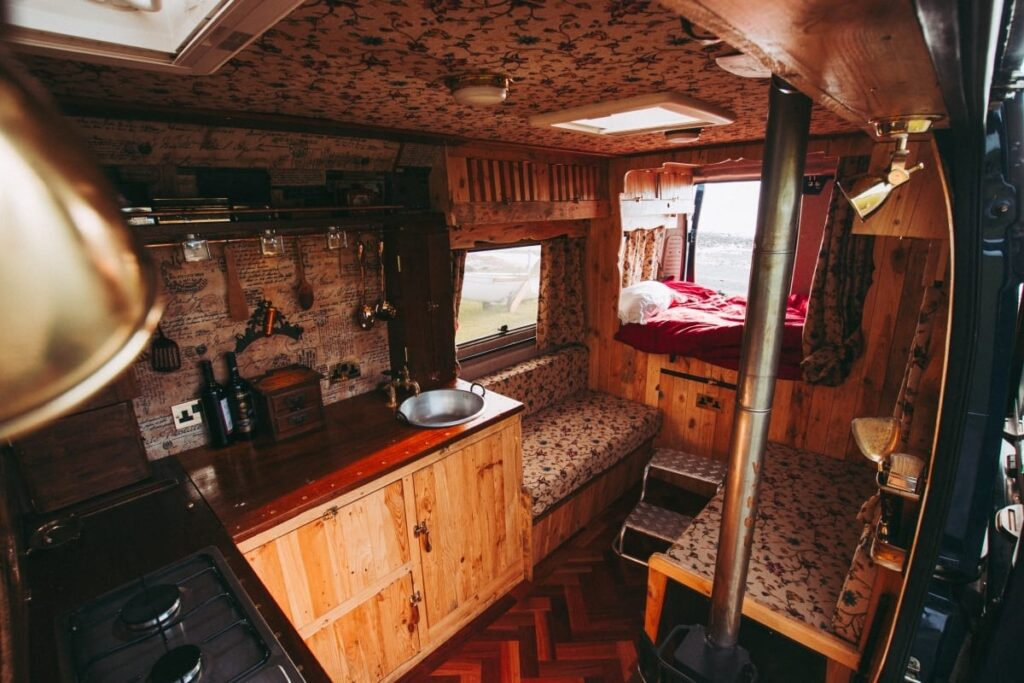The final campervan conversion showing the bed, living and kitchen areas