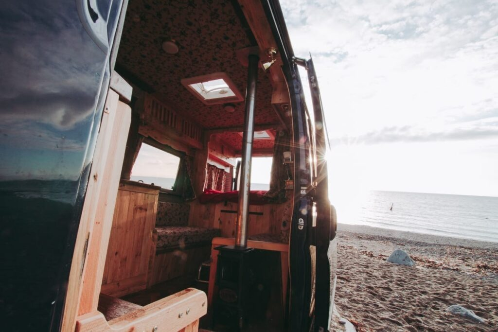 a selfbuilt campervan on a beach in wales