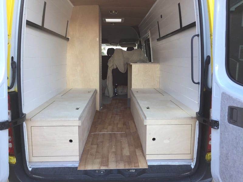 the seats being put into a sprinter van conversion