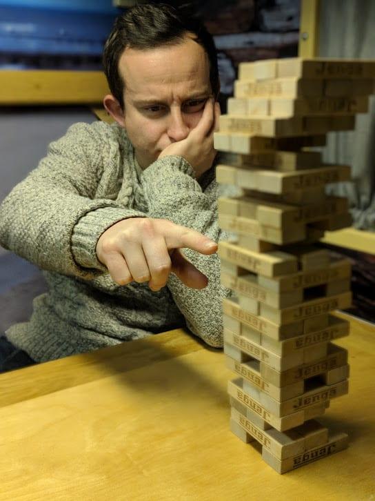 A man playing Jenga