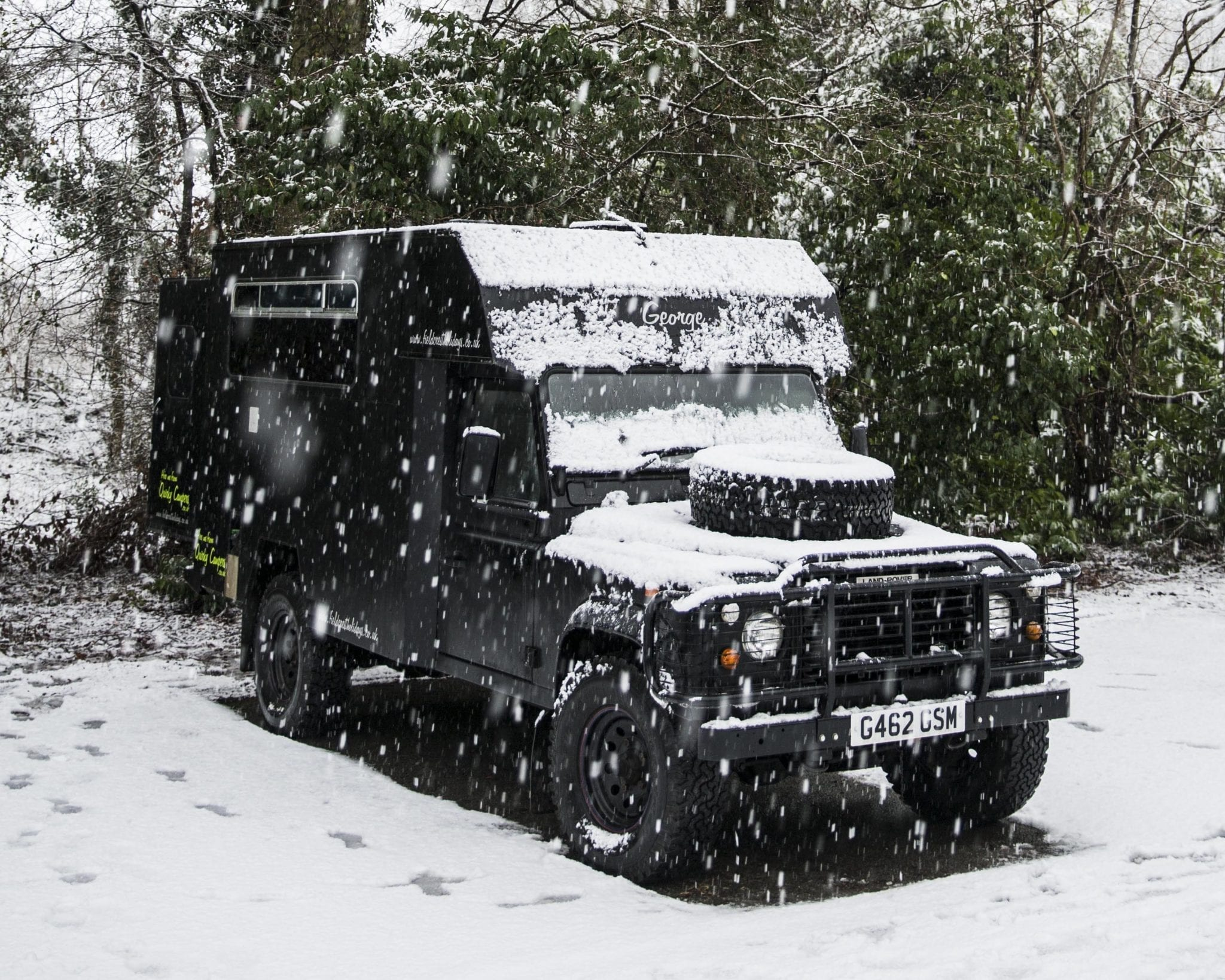 A campervan in the snow on an adventure holiday in UK