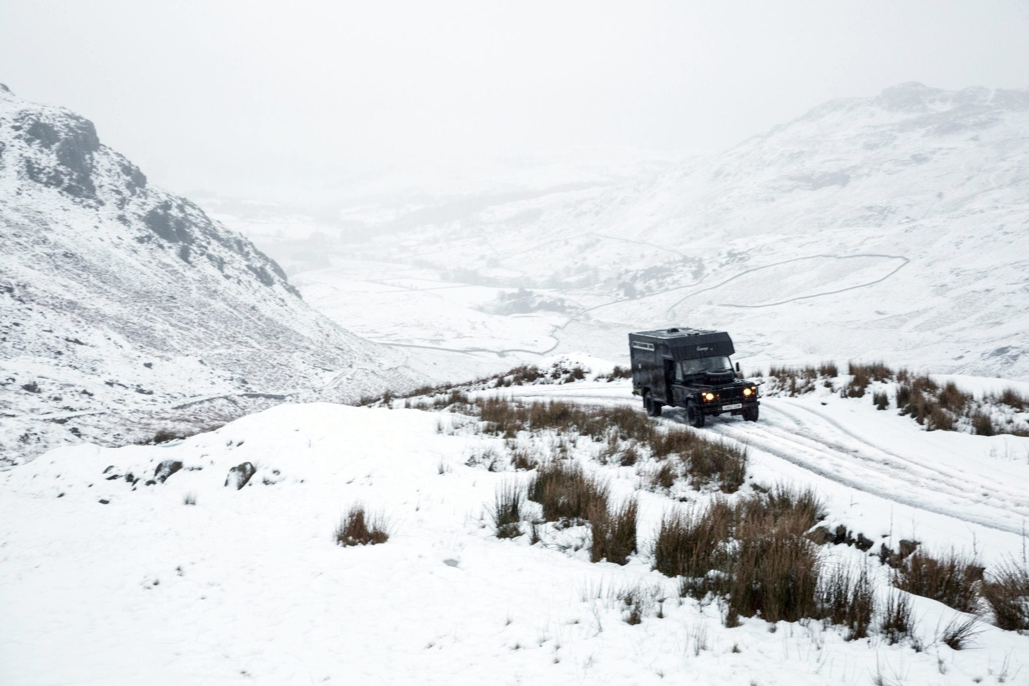 A landrover campervan in the snowy mountains