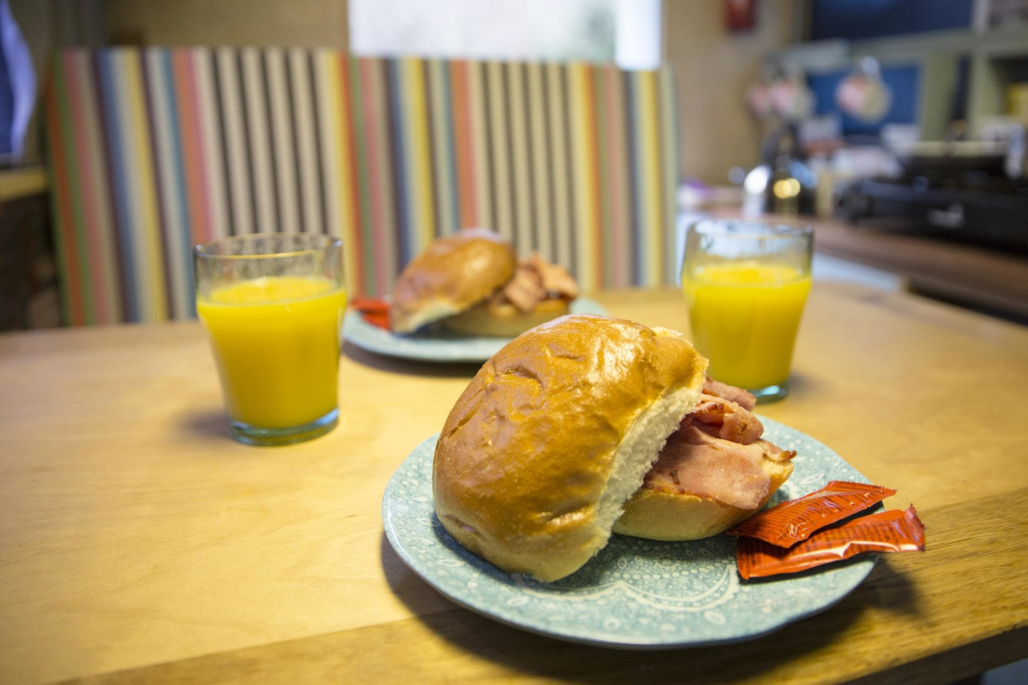 2 bacon bap and 2 glasses of orange juice