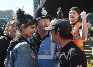 Saffiyah Khan with a police man and a male