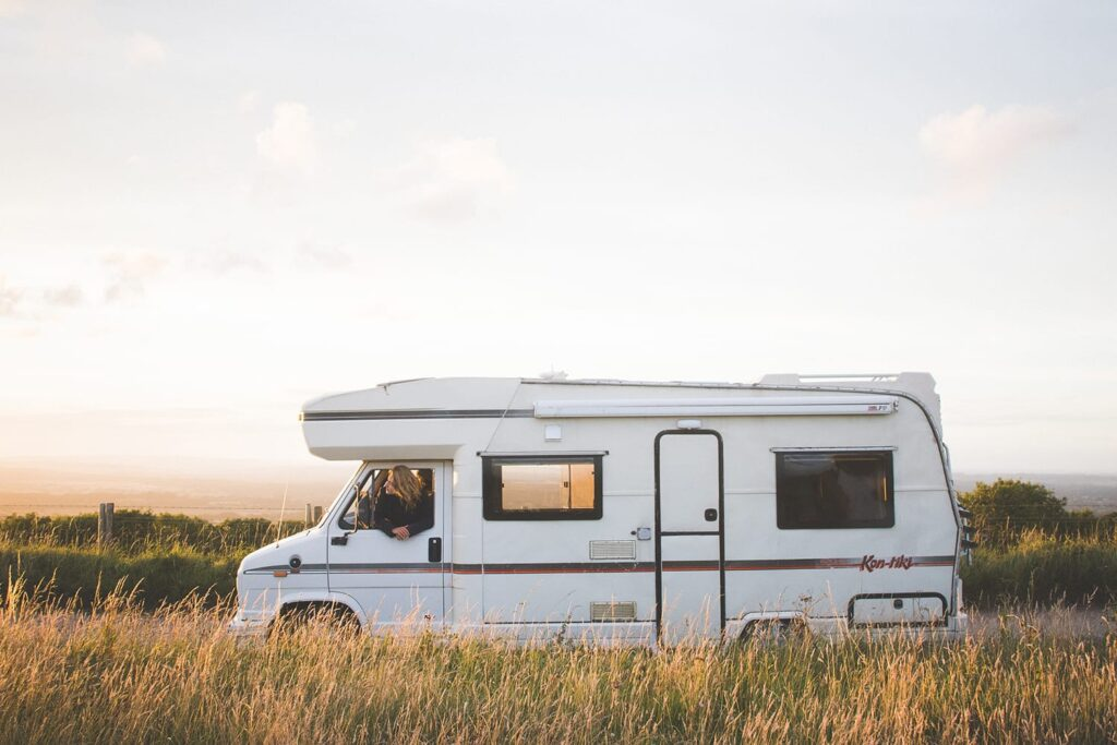 A retro campervan in a field