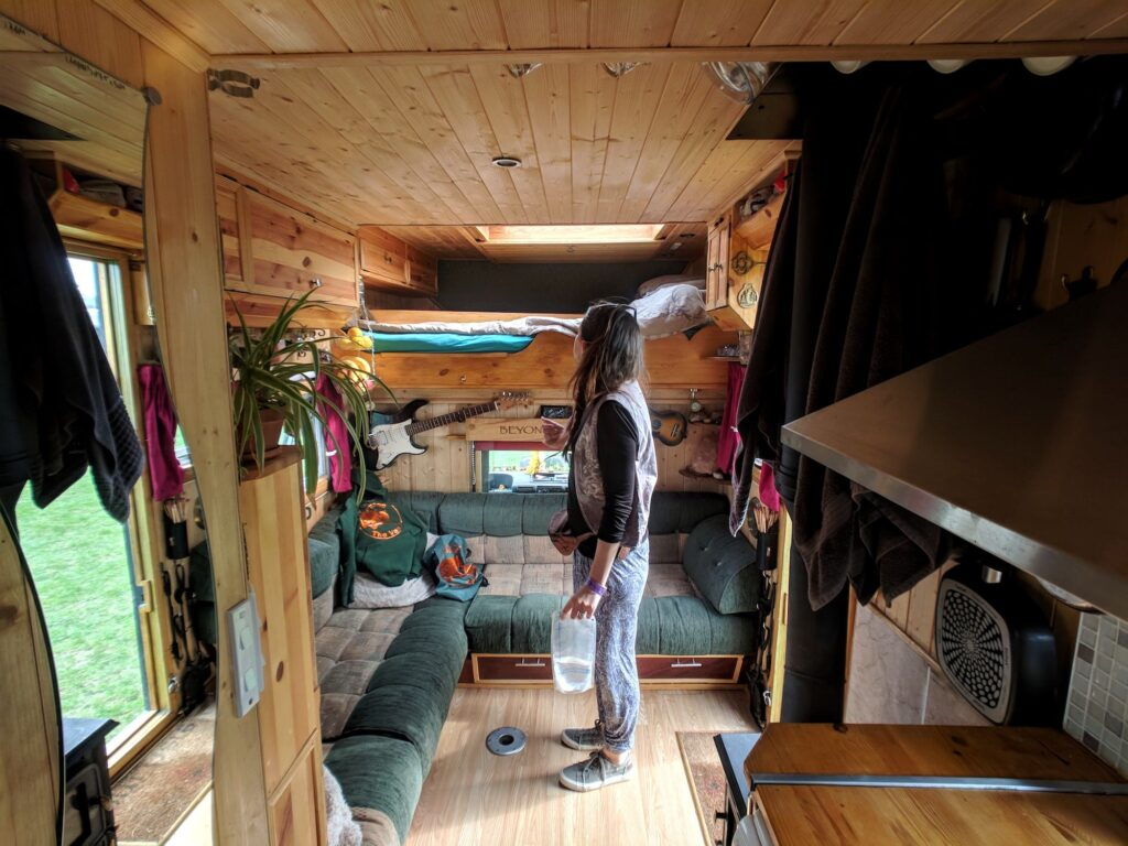 The inside of a selfbuilt campervan including bunk beds and living area