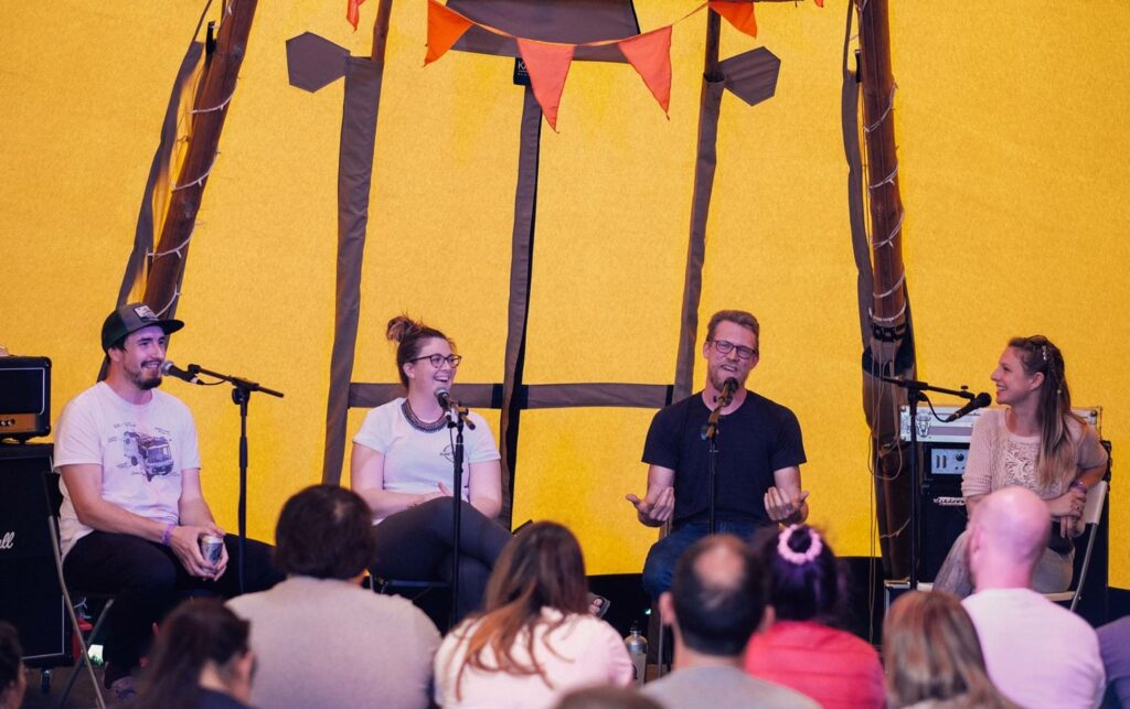 A singing band, The Indie Projects and the Rolling Home at Camp Quirky infront of an audience