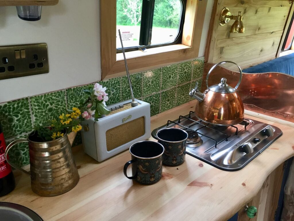 Making tea in a campervan whilst wild camping