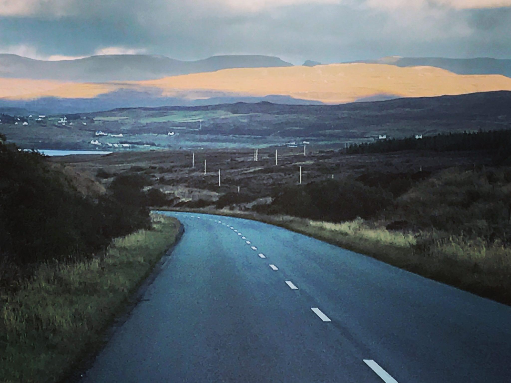 Moody sky on an empty windy road in Scotland