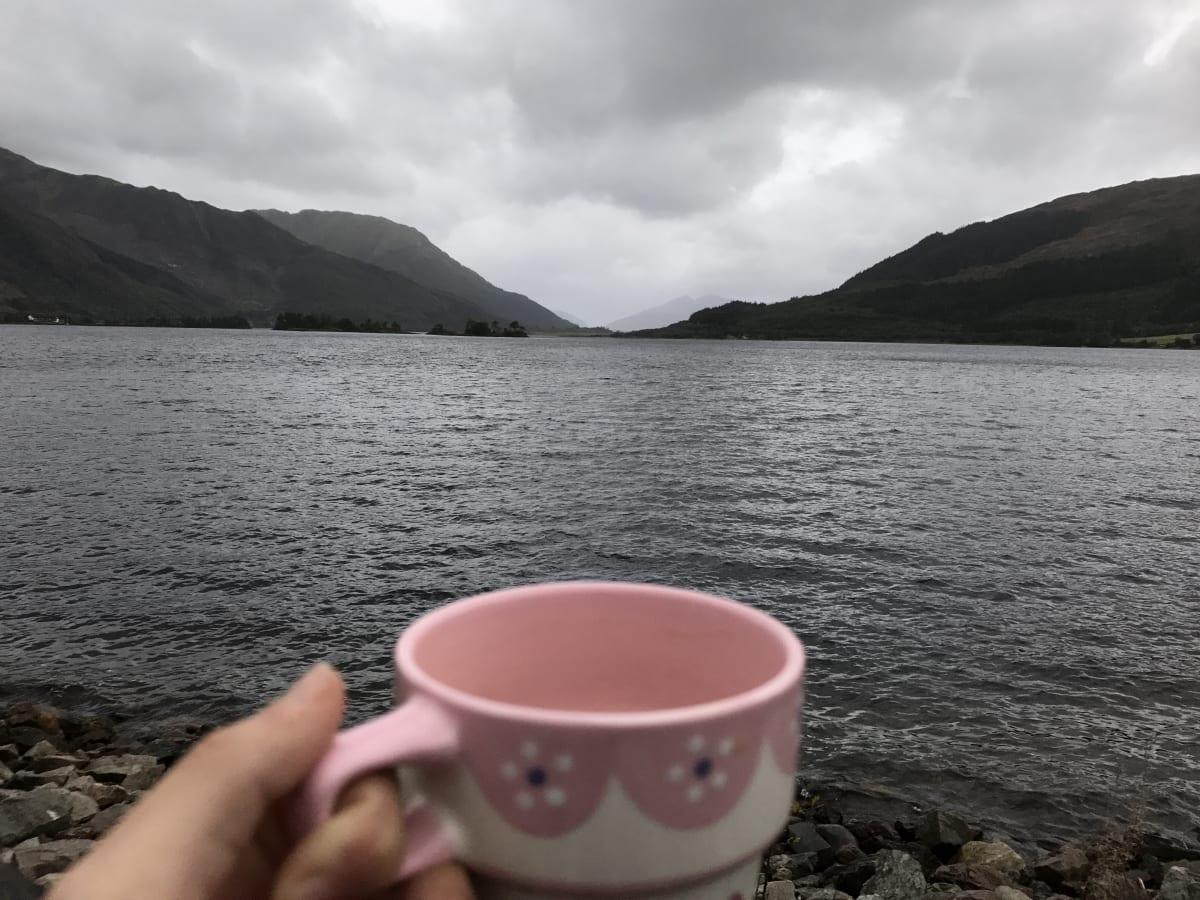 morning coffee mug overlooking Loch in Scotland