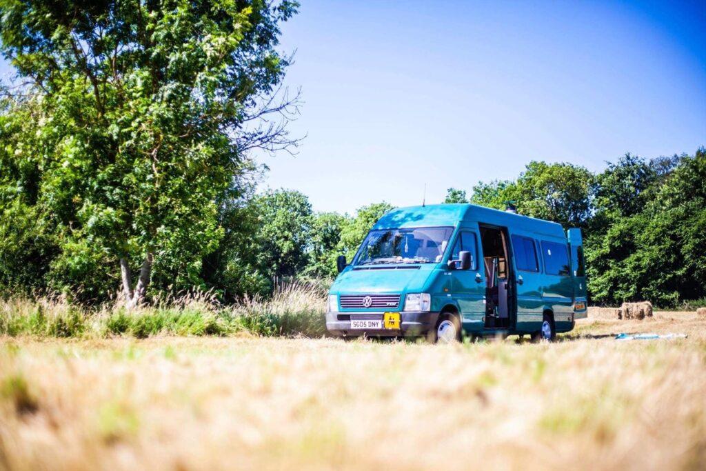 Blue campervan in a field