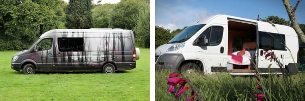 The exterior of two campervans. One is plain white and the other has silhouetted trees spray painted on