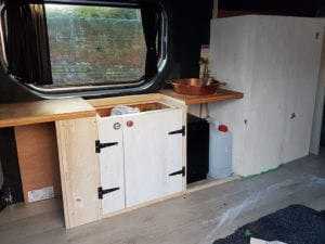 Campervan conversion with doors and cupbards