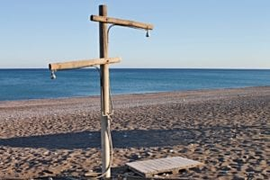 keep clean on the beach by using the free showers available