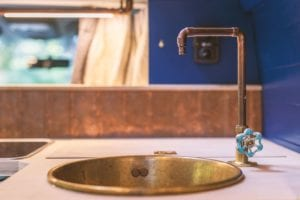 copper sink and tap for washing up in a campervan