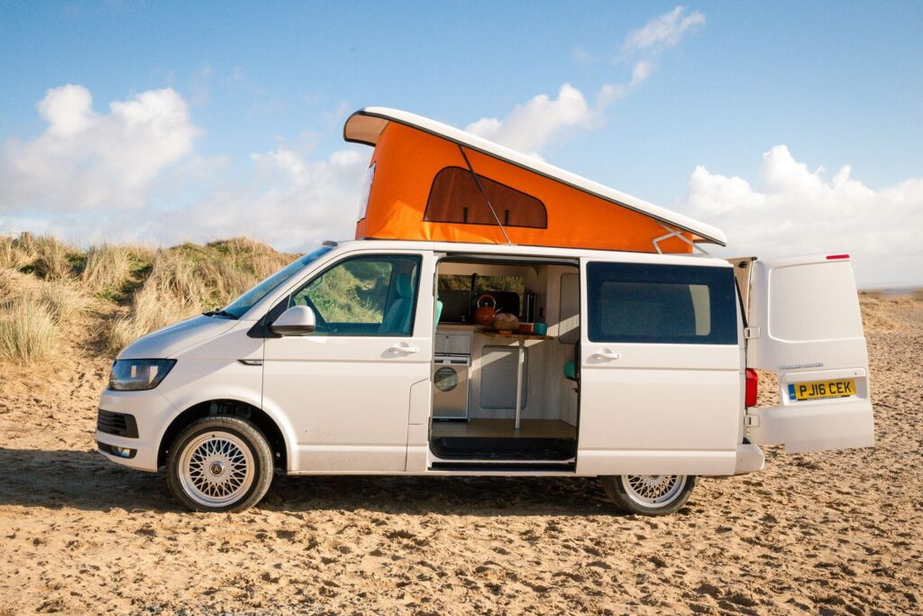 T5 campervan with pop top roof ont he beach
