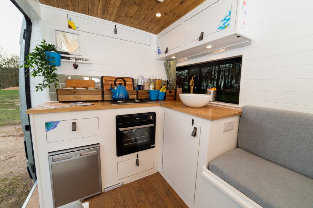 modern campervan kitchen with oven